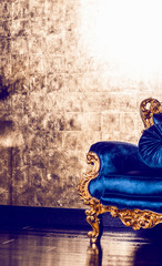 Classical blue royal sofa on luxurious interior background