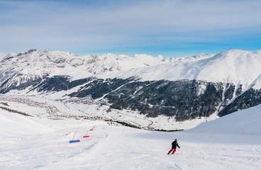 Skier on the slope of  Ski resort Livigno. Italy