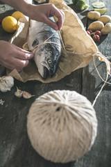 Tying a rope on samon fish