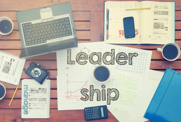 notebook with the note in the center about Leadership