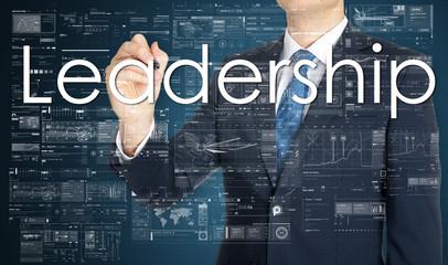 businessman writing Leadership and drawing graphs and diagrams