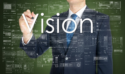 the businessman is writing Vision on the transparent board with