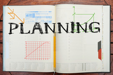 paper notebook with inscription planning , business concept