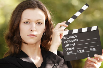 Closeup of Woman's Face and Open Clapboard