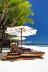 Fototapete - Sun umbrellas and beach chairs on a beautiful island, Boracay