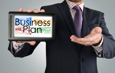 Businessman showing business concept on tablet - Business Plan