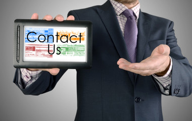 Businessman showing business concept on tablet - Contact Us