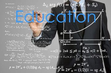 businessman handwriting Education on a transparent board