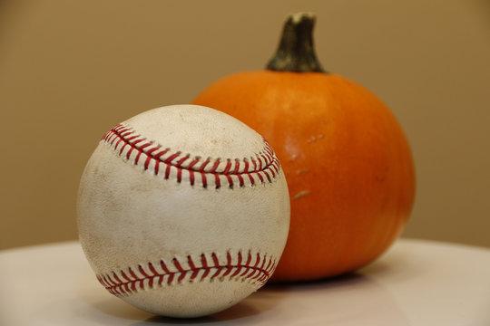 Objects: Baseball and pumpkin (orange)