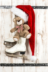 Red Santas hat, Teddy Bear and white ice skates