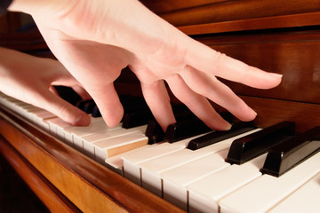 A pianist playing the piano with both hands.