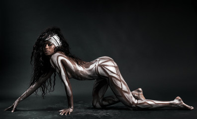 Tuinposter Ikea Sexy african model body painted with polygons