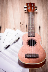 Ukulele and musical paper notes