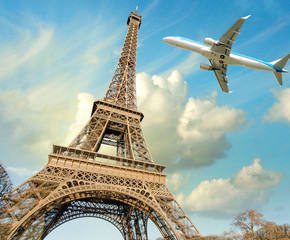 Airplane overflying Eiffel Tower in Paris
