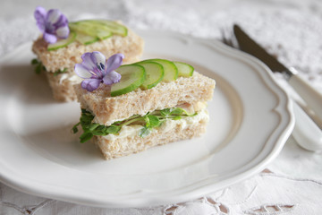 Homemade chicken cucumber cream cheese sandwiches with purple flo