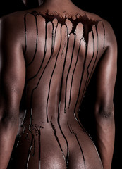 Sensual african model back covered with chocolate drops