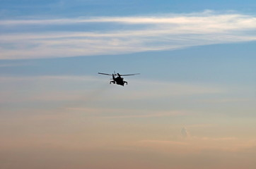 silhouette combat helicopter against the sky