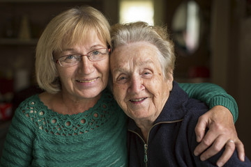 Portrait of an adult woman with his elderly mother.
