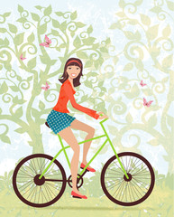 Happy girl on a bike outdoors in spring