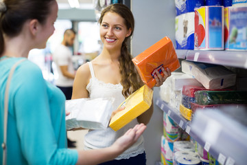 Girl buying napkins for kitchen