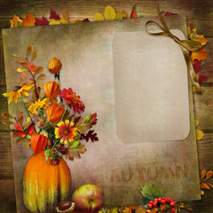 Vintage background with autumn leaves, flowers in a vase from pumpkin with card