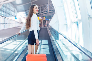 woman on travelator in airport