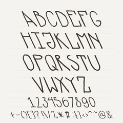English hand-drawn alphabet of capital letters tilted to the