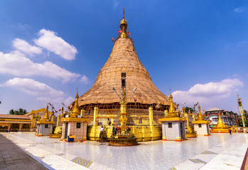Botataung pagoda in repair with clear blue sky and clouds