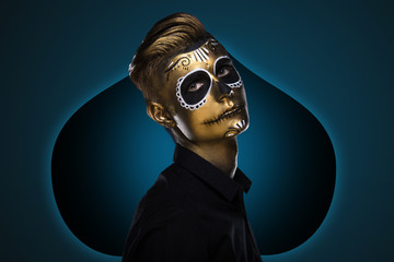 The guy with the painted face for Halloween. Masquerade Party. Night festivities dressed as zombies. Face art