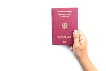 Close up hand holding German passport isolated on white