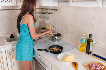 Young woman preparing a meal of spaghetti