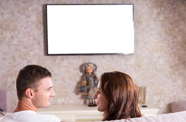 Couple Looking at Each Other in front of TV