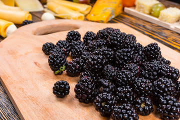 Pile of Fresh Picked Blackberries on Wooden Board