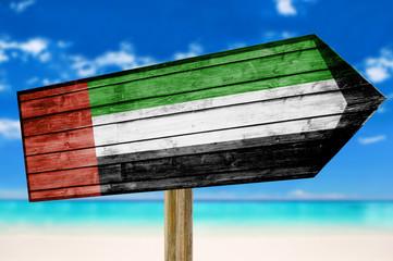 United Arab Emirates Flag wooden sign on beach background