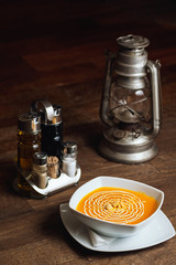 Vegetable soup, pumpkin pottage on a wooden table