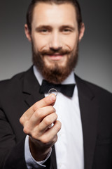 Attractive young bearded man is carrying jewelry