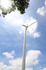 Wind turbine under blue sky - Clean Energy genesis