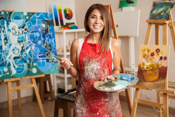 Beautiful female artist in her studio