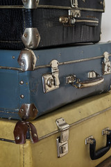 Antique Suitcases in a Stack, toned photo in retro style.