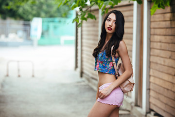 beautiful girl poses for camera in the city