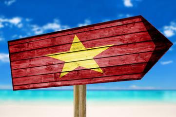 Vietnam Flag wooden sign on beach background