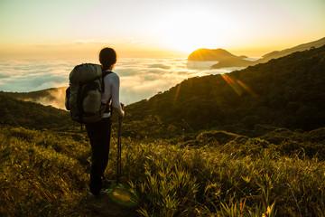 Hiker enjoying the Sunset and Amazon Forest
