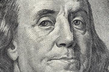 Benjamin Franklin's face on the US 100 dollar bill