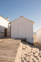 White little houses on the sunny beach