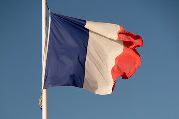 the french flag under a blue sky