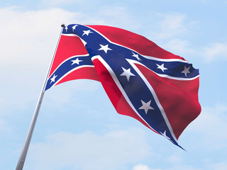 Confederate States of America flag flying on clear sky.