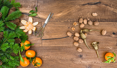Orange mandarin fruits, walnuts and vintage accessories