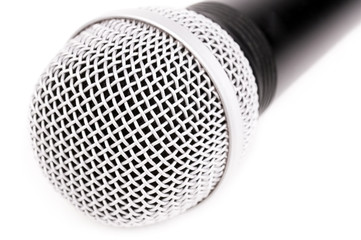 Microphone closeup on white background