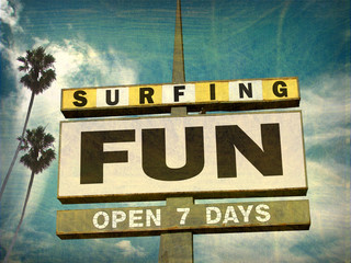 aged and worn vintage photo of surfing fun sign