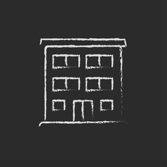Residential building icon drawn in chalk.